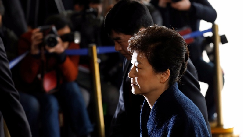 Park says 'sorry' as she heads for questioning