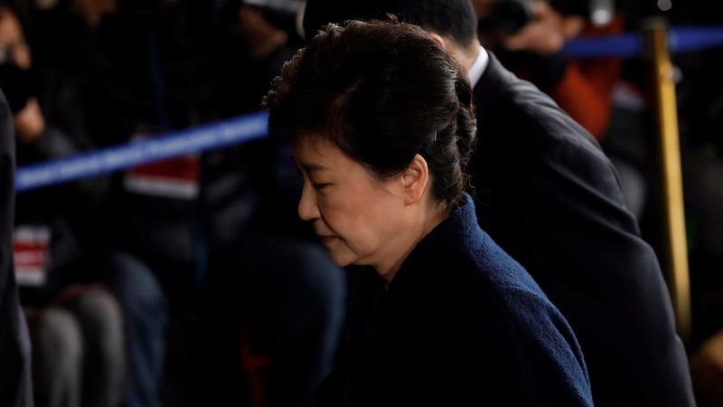 Park says 'sorry' as she heads for a marathon grilling