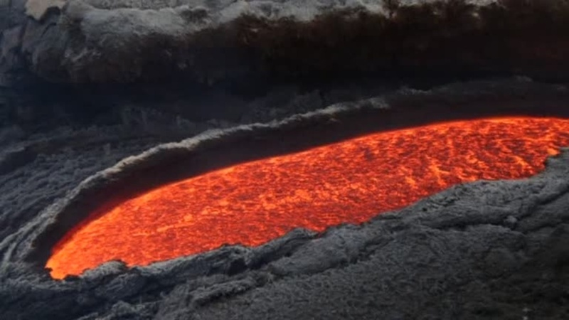 INSIGHT: Lava pours out of Mt Etna