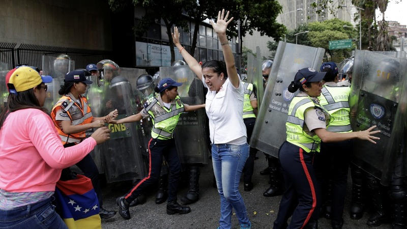 Venezuela court backtracks to quell outrage