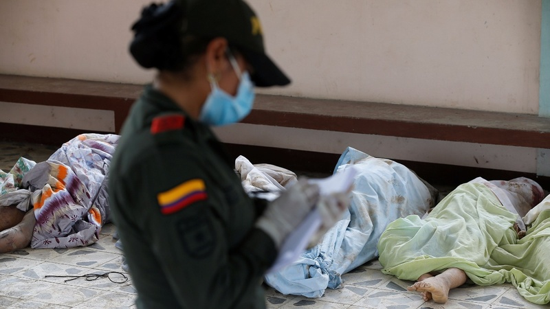 Devastated Colombians identify victims of mudslides
