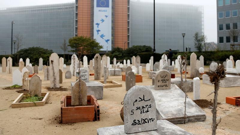 INSIGHT: NGO installs mock cemetery near EU