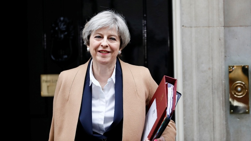 UK PM hints at softer Brexit on immigration