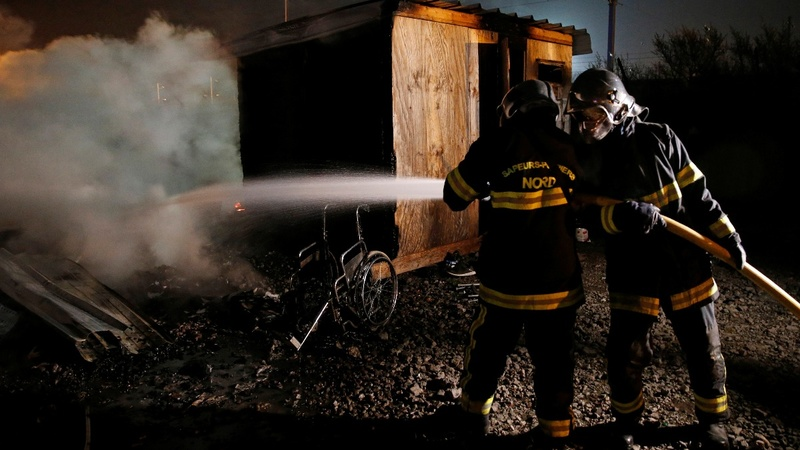 Fire ravages migrant camp in France