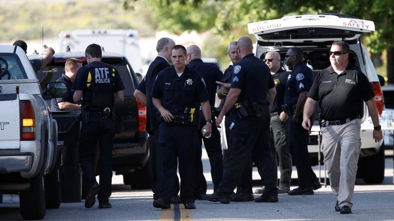 Police probe gunman's motives in San Bernardino shooting