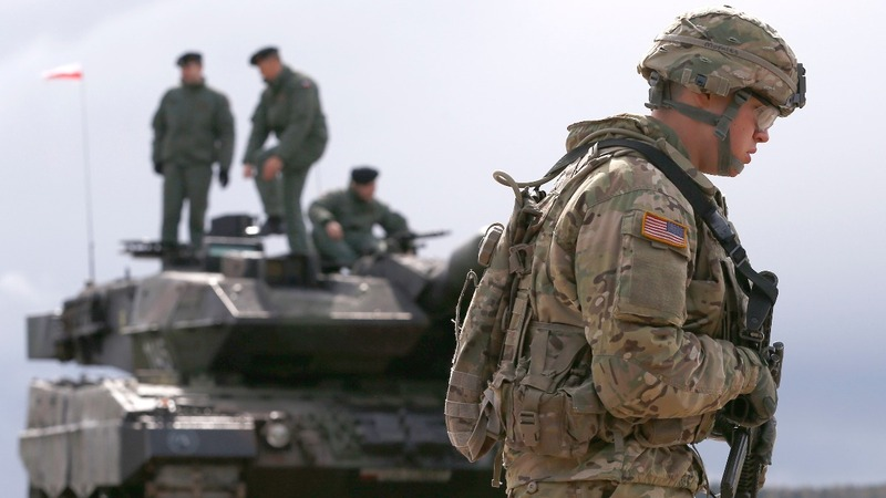INSIGHT: NATO troops welcomed to Poland