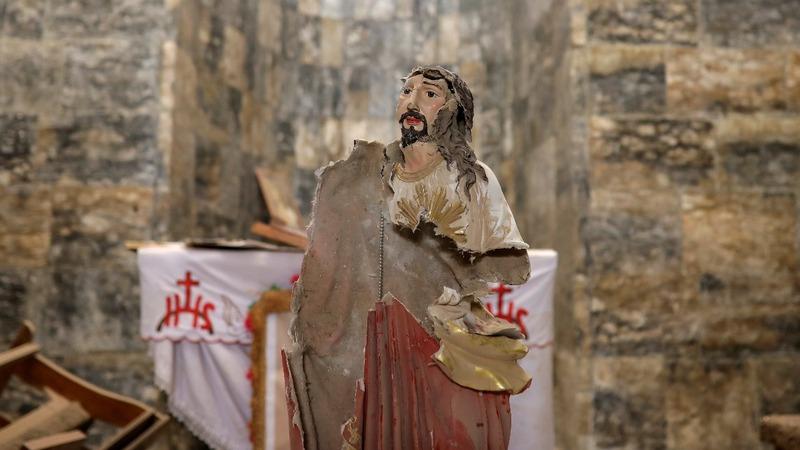 Iraqi Christians return to ransacked town