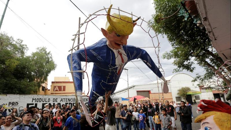 Mexicans burn a Trump effigy on Easter