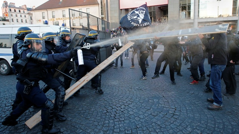 INSIGHT: Election results spark Paris clashes