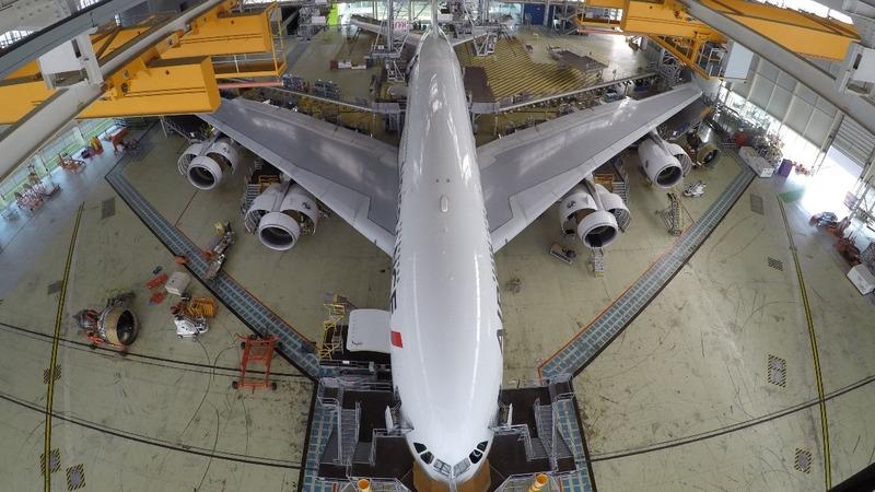 Airbus profit dips on engine delays, price squeeze