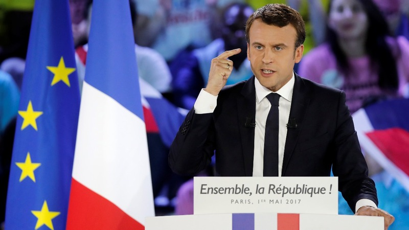 Macron, Le Pen exchange May Day blows