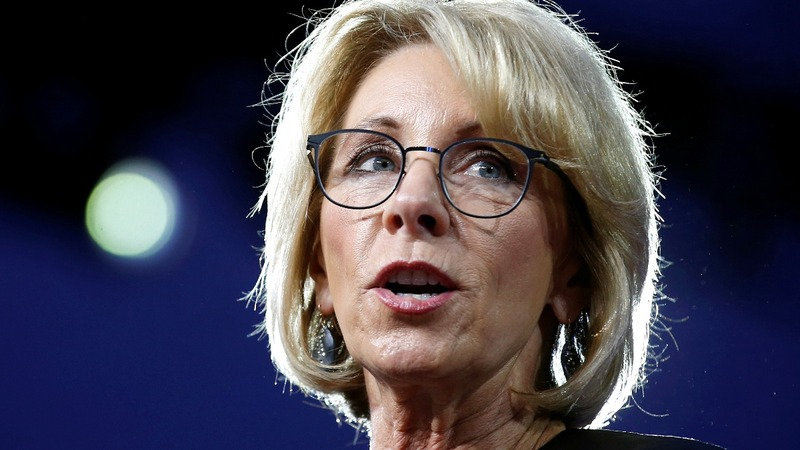Graduates boo, turn their backs on DeVos