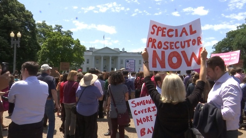 INSIGHT: Protesters demand probe of Comey dismissal