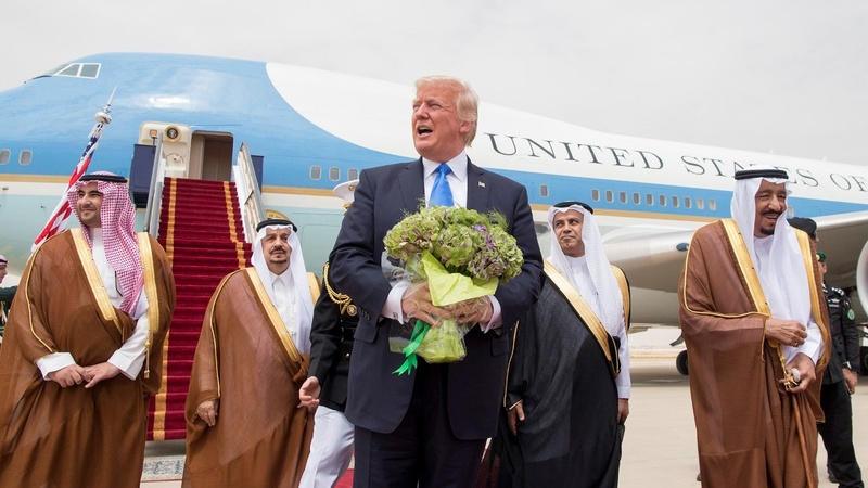 Trump lands in Saudi as troubles mount at home