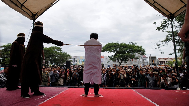 Two caned in Indonesia over gay sex