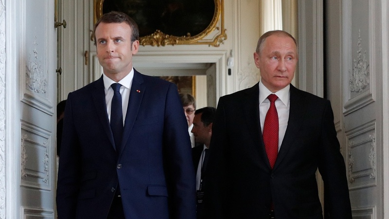 INSIGHT: Macron welcomes Putin at Versailles