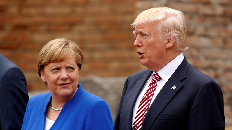 Trump, Merkel stare across widening rift