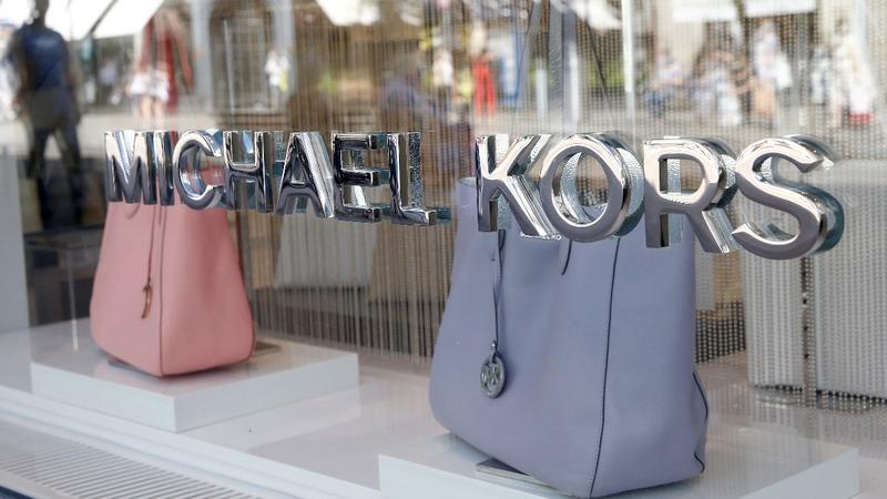 Kors shares plummet as it plans to close stores
