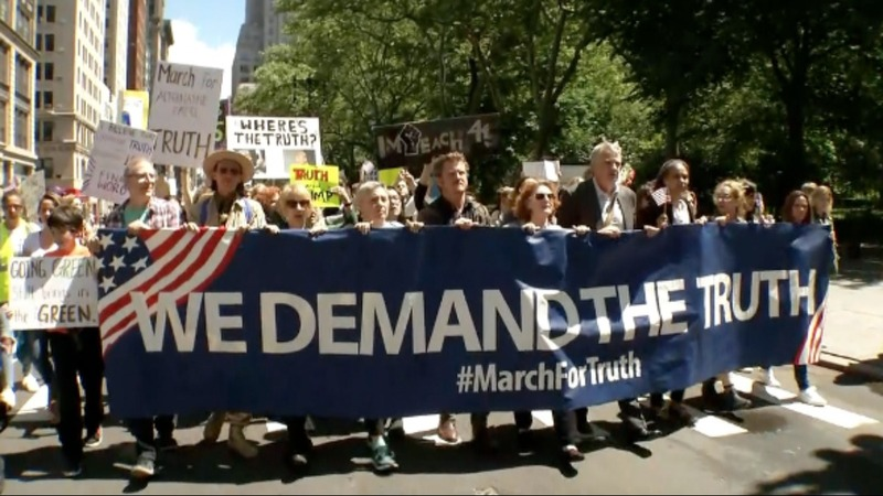 INSIGHT: Protests divide America on climate, healthcare, immigration