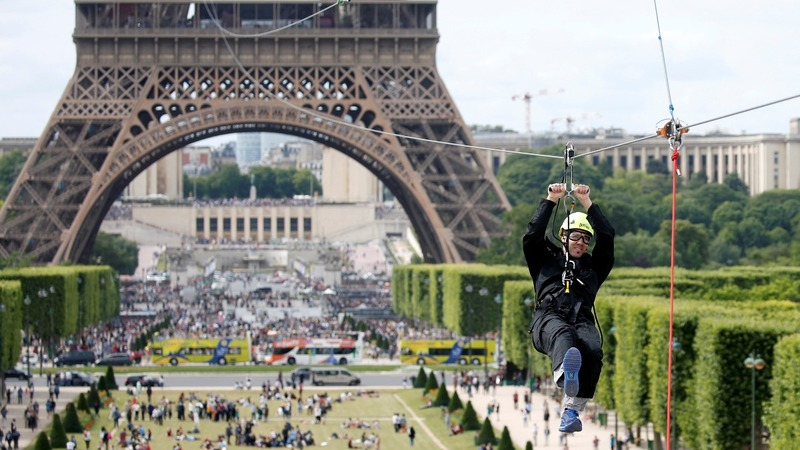 INSIGHT: Thrill seekers zip line from the Eiffel Tower in Paris