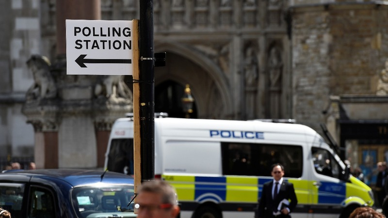 UK election: polls open amid high security