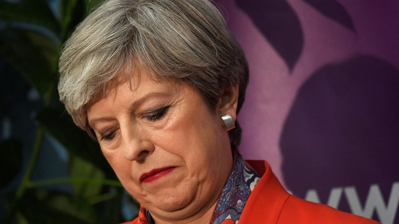 Further blows for UK PM May as top aides quit