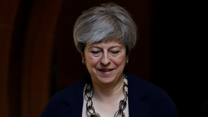 Theresa May forms cabinet amid turmoil