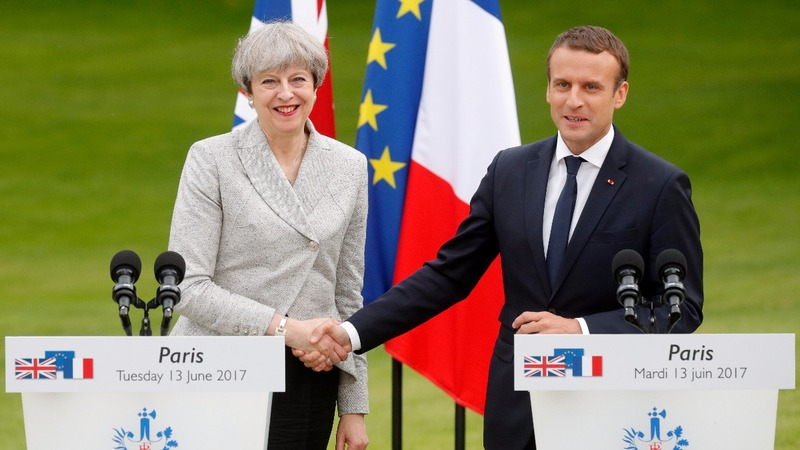 May meets Macron under Brexit pressure