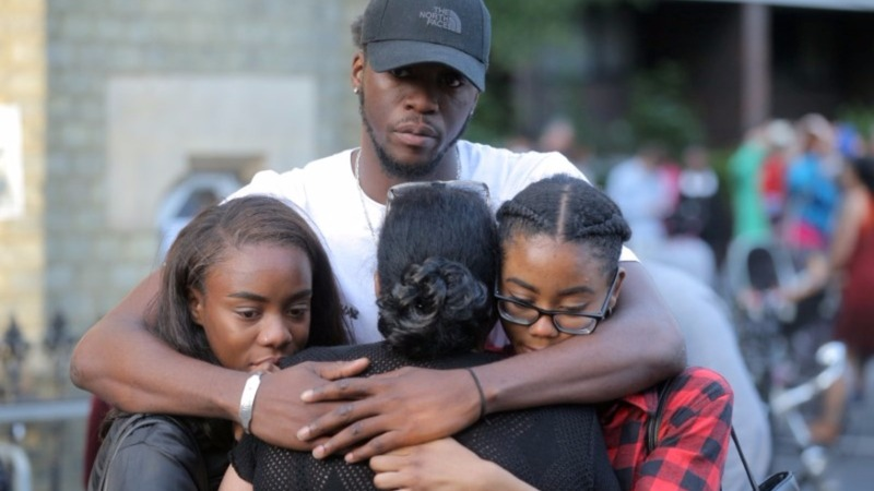Vigil held for London fire victims as rage grows