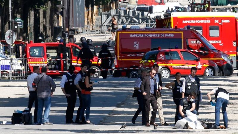 Car rams police car in Paris, attacker shot