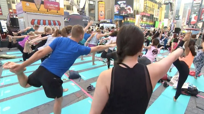 INSIGHT: Yogis mark summer solstice in Times Square