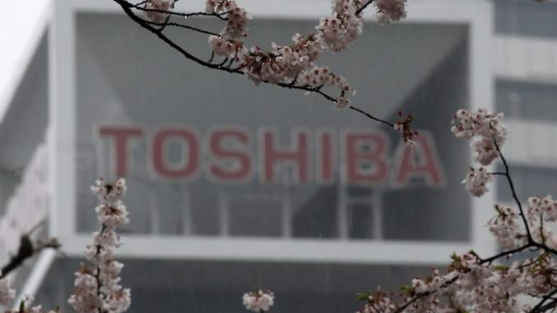 Toshiba shares slide as execs chase $18 bln deal