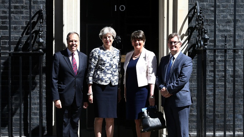 UK PM secures deal to back minority government