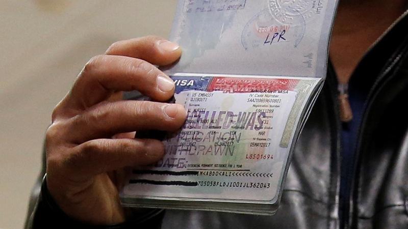 On eve of travel ban, U.S. agencies seeking clarity