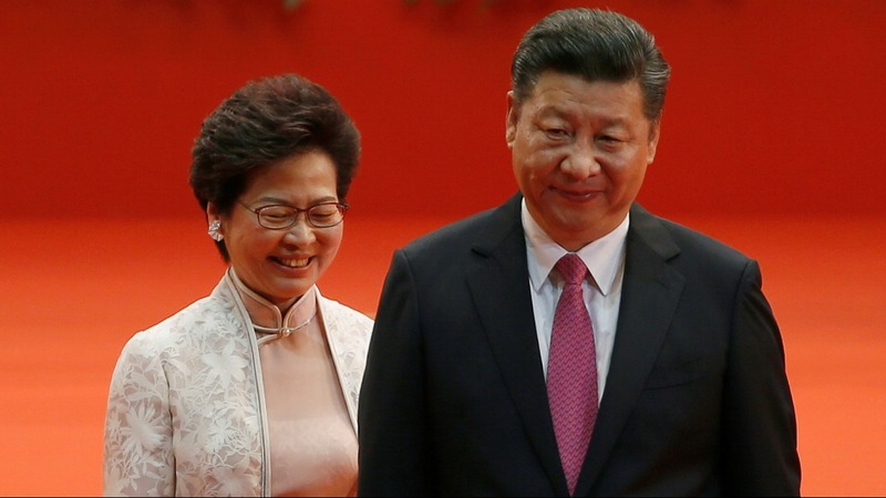 Hong Kong's new leader warned to toe the line