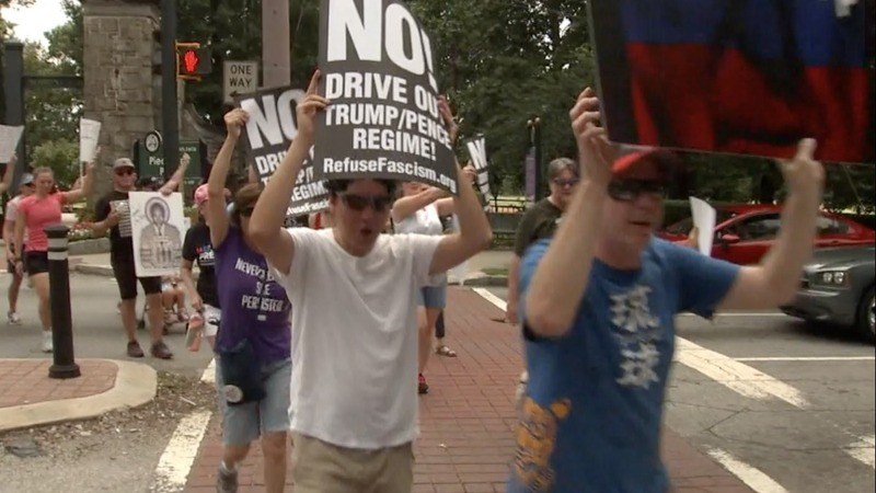 INSIGHT: Demonstrators march to call for Trump's impeachment