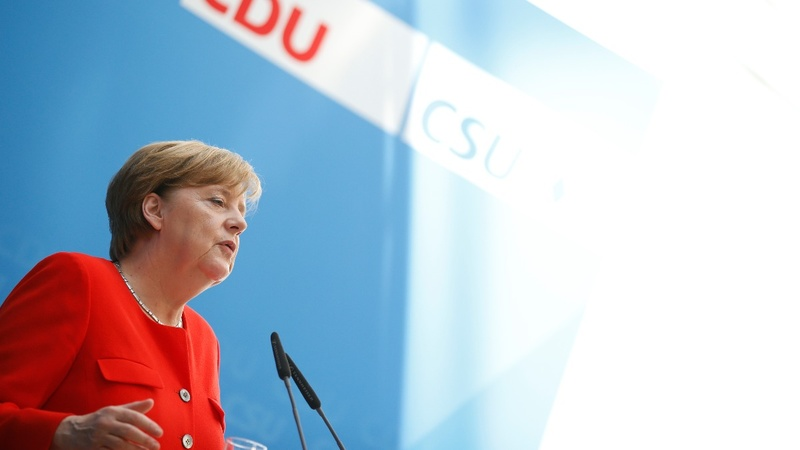 Full employment and a U.S. snub: Merkel's manifesto