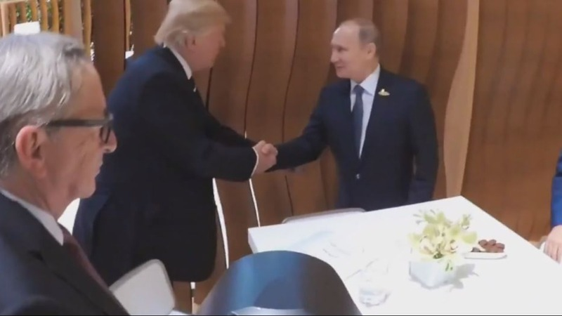 INSIGHT: Trump and Putin shake on it