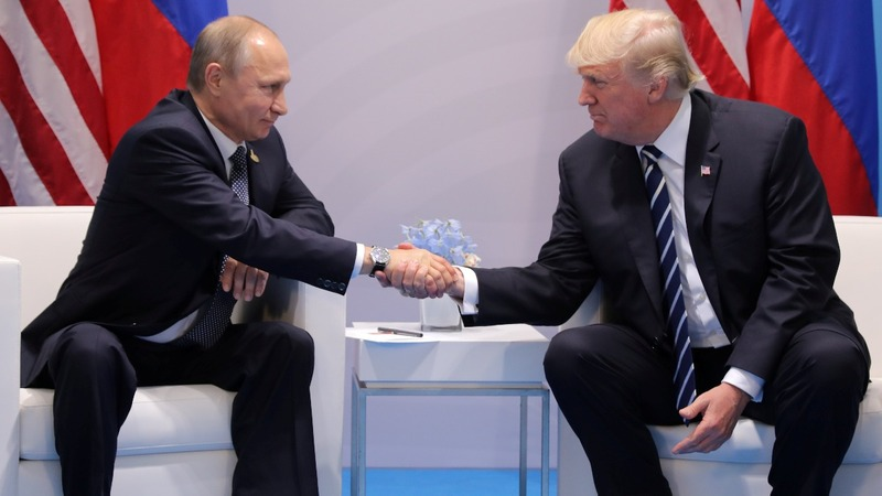 INSIGHT: Trump and Putin officially shake