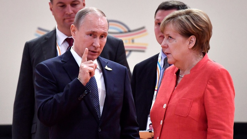 INSIGHT: Merkel lets loose an eyeroll in chat with Putin