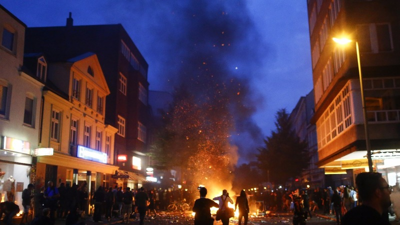 INSIGHT:  Fires flare as protesters, police clash at G20