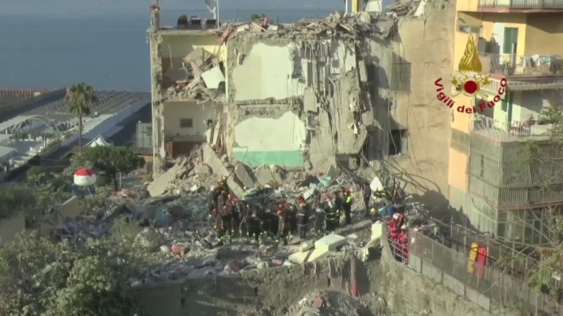Eight bodies found under collapsed building in Italy