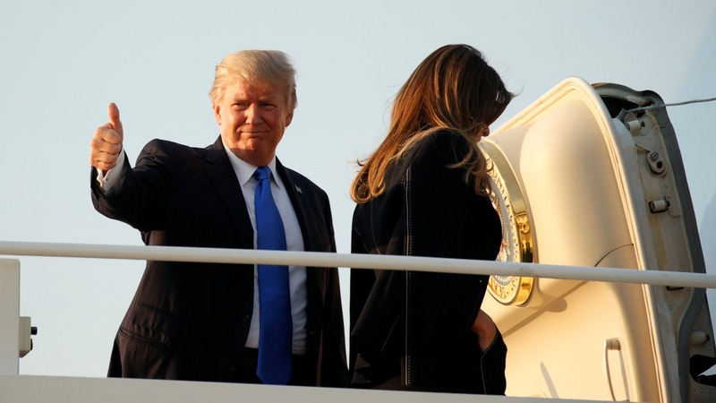Trump visits France's Macron, escaping domestic woes