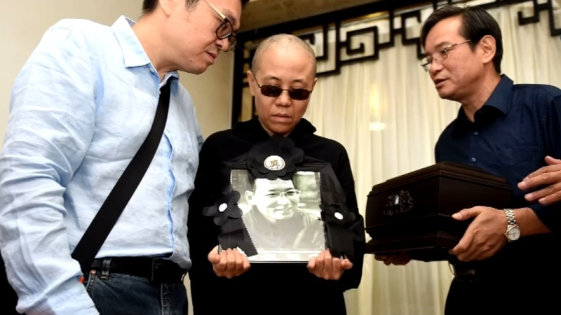 INSIGHT: Chinese dissident Xiaobo's cremated at funeral