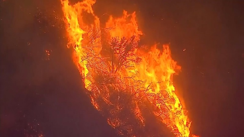 Raging wildfires menace California