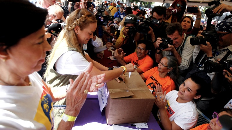 Venezuelans vote in unofficial poll, in defiance of Maduro