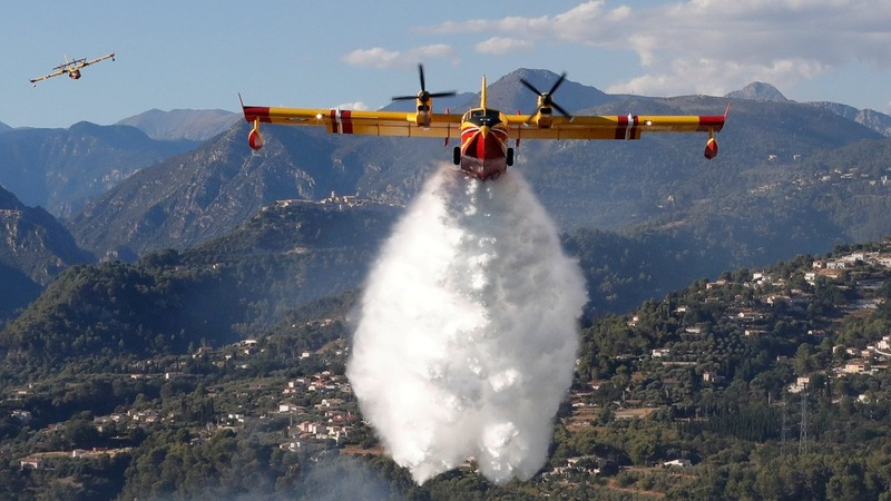 INSIGHT: Wildfire rages through southern France