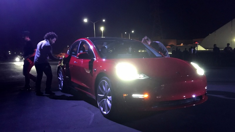 Tesla hands out keys to lower-priced model