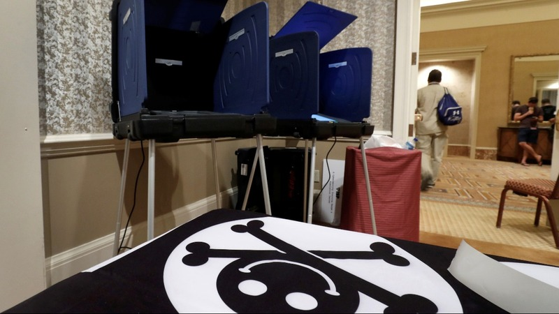 Hackers scour voting machines for security flaws