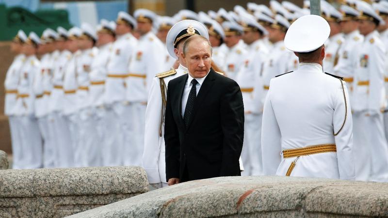 INSIGHT: Putin reviews fleet at Navy Day parade